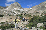 Man hiking in Indian Peaks Wilderness Area, west of Boulder, Colorado, USA. Guided photo tours to Indian Peaks.