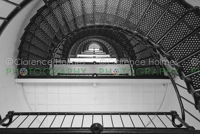View looking up into the tower and spiral staircase of the St. Augustine lighthouse.  The lighthouse, built in 1874, is 165 feet tall, has 219 steps, and 8 landings.