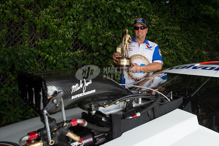 Jun. 2, 2013; Englishtown, NJ, USA: NHRA pro mod driver Mike Janis poses for a portrait after winning the Summer Nationals at Raceway Park. Mandatory Credit: Mark J. Rebilas-