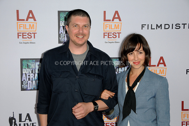 WWW.ACEPIXS.COM . . . . .  ....June 26 2011, Los Angeles....Actor Kent Osborne (L) and actress Amanda Street arriving at the 2011 Los Angeles Film Festival Closing Night Premiere 'Dont Be Afraid Of The Dark' at Regal Cinemas L.A. Live on June 26, 2011 in Los Angeles, California. ....Please byline: PETER WEST - ACE PICTURES.... *** ***..Ace Pictures, Inc:  ..Philip Vaughan (212) 243-8787 or (646) 679 0430..e-mail: info@acepixs.com..web: http://www.acepixs.com