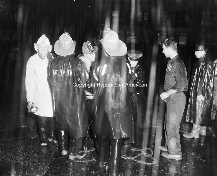 Waterbury firefighters work through the night battling the flood of 1955.