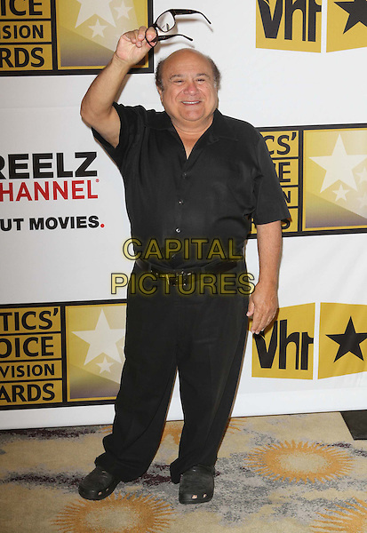 Danny DeVito.1st Annual Critics' Choice Television Awards Luncheon held at The Beverly Hills Hotel, Beverly Hills, California, .20th June 2011..full length black shirt glasses trousers crocs holding hand waving .CAP/ADM/KB.©Kevan Brooks/AdMedia/Capital Pictures.