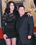 Cher and Chaz Bono at Cher's Hand and Footprint Ceremony where she was honored at The Grauman Chinese Theatre in Hollywood, California on November 18,2010                                                                                    © 2010 Hollywood Press Agency