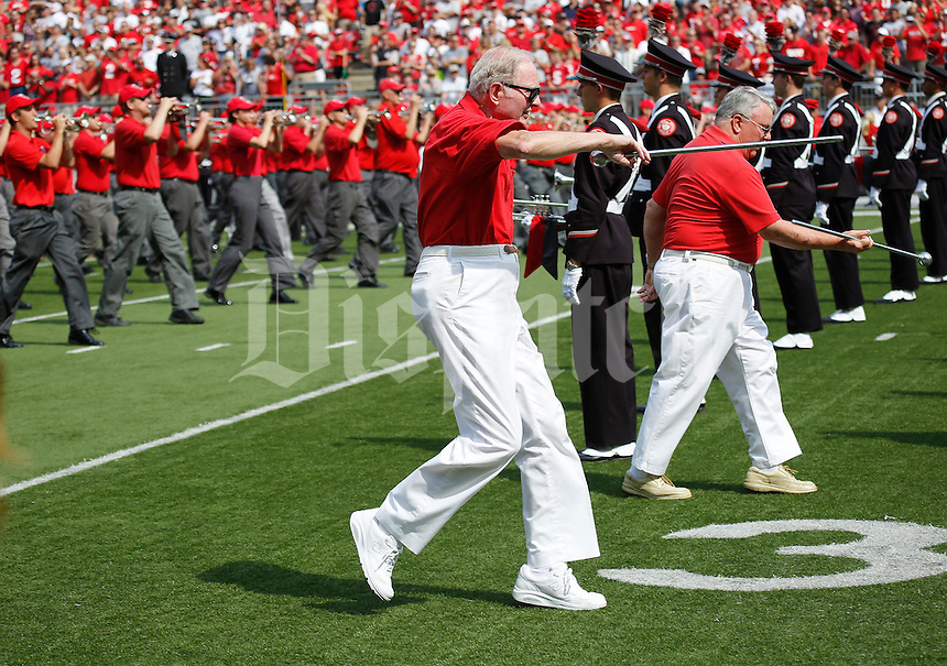 Joe Myers (front), a drum major in 1945 from Upper Arlington, and Cyril Costoff, a drum major in 1944 from Toledo, march across the field with the alumni band prior to the NCAA football game against San Diego State at Ohio Stadium in Columbus on Sept. 7, 2013. (Adam Cairns / The Columbus Dispatch)