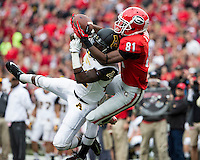 The Georgia Bulldogs beat the App State Mountaineers 45-6 in their homecoming game.  After a close first half, UGA scored 31 unanswered points in the second half.  Georgia Bulldogs wide receiver Reggie Davis (81) catches a pass over Appalachian State Mountaineers defensive back Dante Blackmon (24)