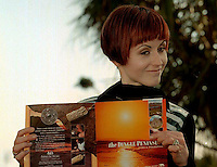 Dolores O'Riordan of The Cranberries with a  Dingle Tourism Brochure  in Dingle, Co. Kerry.<br /> Picture by Don MacMonagle.
