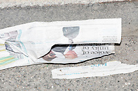 "A torn newspaper is visible on the ground that features a picture of newly-inaugurated President Donald Trump and the headline ""Voice of unity or division?"" near the National Mall after the inauguration of President Donald Trump on Jan. 20, 2017, in Washington, D.C."