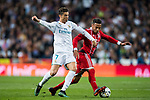Cristiano Ronaldo (L) of Real Madrid fights for the ball with Corentin Tolisso of FC Bayern Munich during the UEFA Champions League Semi-final 2nd leg match between Real Madrid and Bayern Munich at the Estadio Santiago Bernabeu on May 01 2018 in Madrid, Spain. Photo by Diego Souto / Power Sport Images