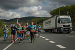 "People run on the 20th Korrika.  Irun (Basque Country). April 4, 2017. The ""Korrika"" is a relay course, with a wooden baton that passes from hand to hand without interruption, organised every two years in a bid to promote the basque language. The Korrika runs over 11 days and 10 nights, crossing many Basque villages and cities. This year was the 20th edition and run more than 2500 Kilometres. Some people consider it an honour to carry the baton with the symbol of the Basques, ""buying"" kilometres to support Basque language teaching. (Gari Garaialde / Bostok Photo)"