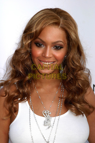 "BEYONCE.Launches new Tommy Hilfiger frangrance ""True Star"".at Chelsea Art Museum, New York City, USA,.24th June 2004..portrait headshot white vest top silver chains necklaces jewellery.www.capitalpictures.com.sales@capitalpictures.com.©Capital Pictures"