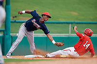 Atlanta Braves Darling Florentino (18) reaches out to tag Antoine Jean (14) as he slides into third base during a Florida Instructional League game against the Canadian Junior National Team on October 9, 2018 at the ESPN Wide World of Sports Complex in Orlando, Florida.  (Mike Janes/Four Seam Images)