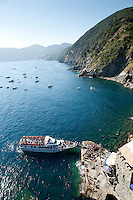 Ferry arriving at Vernazza on the Cinque Terre, Liguria, Italy
