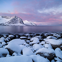 Snow covers rocky coastline at Steinfjord, Senja, Norway