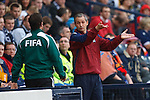 George Burley has words with the fourth official