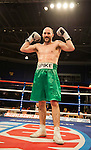 GLASGOW, SCOTLAND - MARCH 10: Gary O'Sullivan (green shorts) defeats Paul Morby to win their Welterweight contest on the Ricky Burns undercard at the Braehead Arena on March 10, 2012 in Glasgow, Scotland. (Photo by Rob Casey/Getty Images)