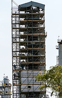 Workers wrap a large reactor at Shell Corunna Refinery