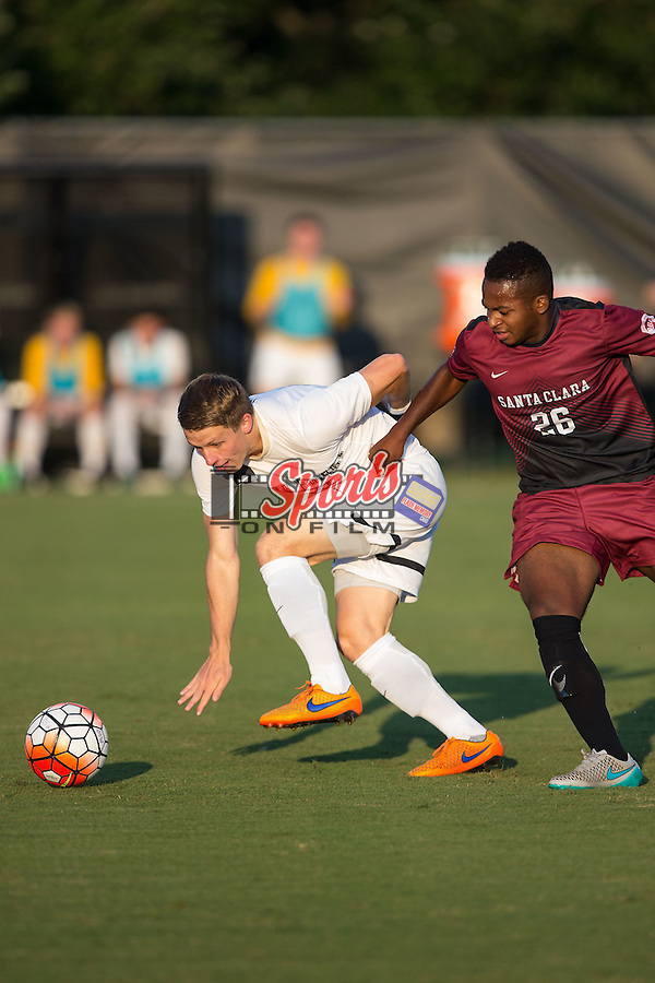 Brad Dunwell (12) of the Wake Forest Demon Deacons battles for the ball with Jonathan Jarrett (26) of the Santa Clara Broncos during first half action at Spry Soccer Stadium on August 28, 2015 in Winston-Salem, North Carolina.  The Demon Deacons defeated the Broncos 1-0.  (Brian Westerholt/Sports On Film)