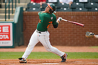 Scott Lawson #2 of the Miami Hurricanes follows through on his swing against the Boston College Eagles at the 2010 ACC Baseball Tournament at NewBridge Bank Park May 27, 2010, in Greensboro, North Carolina.  The Eagles defeated the Hurricanes 12-10 in 10 innings.  Photo by Brian Westerholt / Four Seam Images