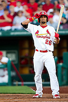 Adam Melker (26) of the Springfield Cardinals reads the batting signals during a game against the St. Louis Cardinals at Hammons Field on April 2, 2012 in Springfield, Missouri. (David Welker/Four Seam Images)