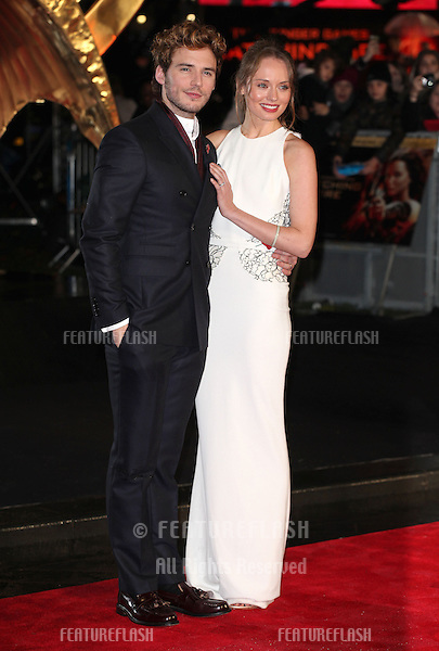 Sam Claffin and Laura Haddock arriving for The Hunger Games, Catching Fire World Premiere, London Leicester Square. 11/11/2013 Picture by: Alexandra Glen / Featureflash