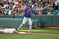 Ronald Guzman (19) of the Round Rock Express on defense against the Salt Lake Bees in Pacific Coast League action at Smith's Ballpark on August 13, 2016 in Salt Lake City, Utah. Round Rock defeated Salt Lake 7-3.  (Stephen Smith/Four Seam Images)