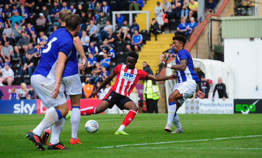Lincoln City's Jordan Adebayo-Smith scores his side's first goal<br /> <br /> Photographer Chris Vaughan/CameraSport<br /> <br /> Football Pre-Season Friendly - Lincoln City v Sheffield Wednesday - Saturday July 13th 2019 - Sincil Bank - Lincoln<br /> <br /> World Copyright © 2019 CameraSport. All rights reserved. 43 Linden Ave. Countesthorpe. Leicester. England. LE8 5PG - Tel: +44 (0) 116 277 4147 - admin@camerasport.com - www.camerasport.com
