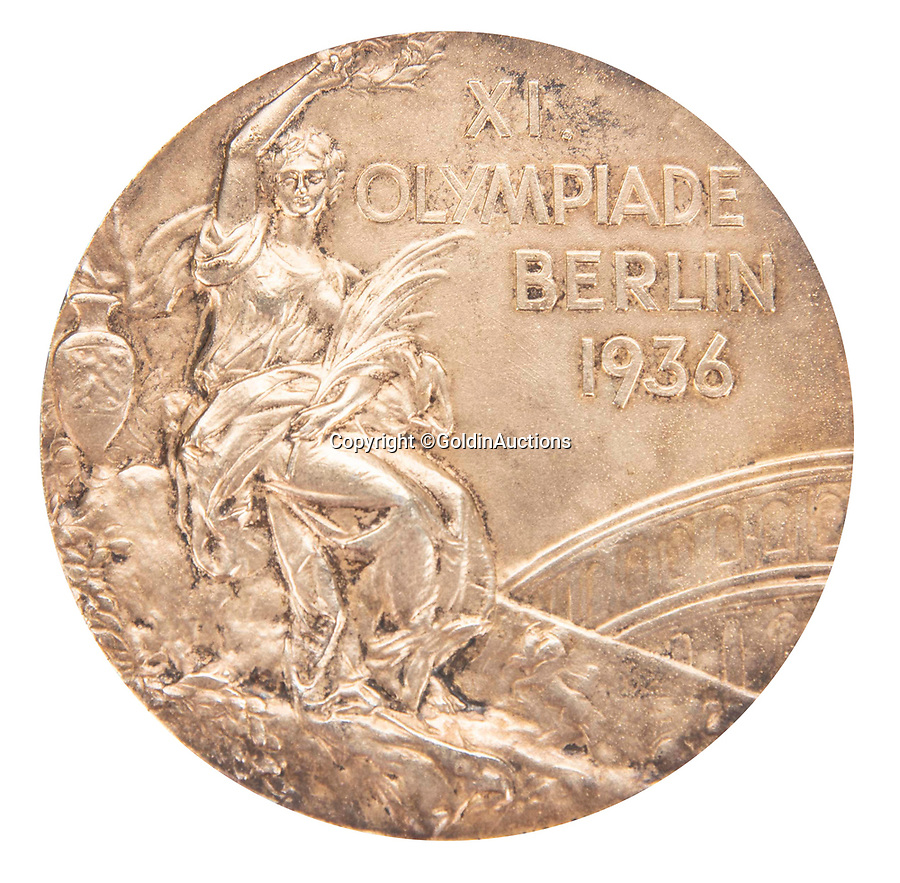 BNPS.co.uk (01202 558833)<br /> Pic: GoldinAuctions/BNPS<br /> <br /> Obverse - '11th Olympiad Berlin 1936' - winged Victory with laurel palm and winners crown.<br /> <br /> Jesse Owens Berlin Gold medal<br /> <br /> One of the four historic gold medal that Jesse Owens won during the notorious 1936 Berlin Olympics has emerged for sale for the very first time for a whopping £1.6m ($2m)<br /> <br /> Owens won four medals in a golden riposte to the watching Nazi high command during the games throwing the idea of Aryan supremacy back into Hitler's face.<br /> <br /> Of the quartet of prizes - awarded for the 100 meters, 200 meters, long jump and 4×100-meter relay - only one has ever been sold before.<br /> <br /> The award is going under the hammer with Goldin Auctions of Camden County, New Jersey.