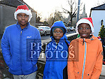 Junior and Prince Uba and Tobi Achioya who took part in the Termonfeckin Celtic FC Santa run. Photo:Colin Bell/pressphotos.ie