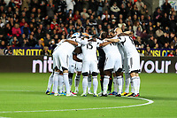 Pictured: Swansea players huddle before kick off.<br /> Monday 16 September 2013<br /> Re: Barclay's Premier League, Swansea City FC v Liverpool at the Liberty Stadium, south Wales.