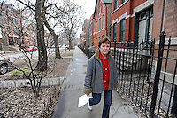 Carol Mrowka walks down the street in her neighborhood, the East Village section of West Town, on Chicago's Near Northwest Side whose landmark distinctions she finds contentious at worst and absurd at best in Chicago, Illinois on March 23, 2009.