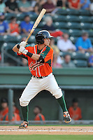 Third baseman Brian Schales (43) of the Greensboro Grasshoppers bats in a game against the Greenville Drive on Tuesday, August 25, 2015, at Fluor Field at the West End in Greenville, South Carolina. Greenville won, 7-0. (Tom Priddy/Four Seam Images)