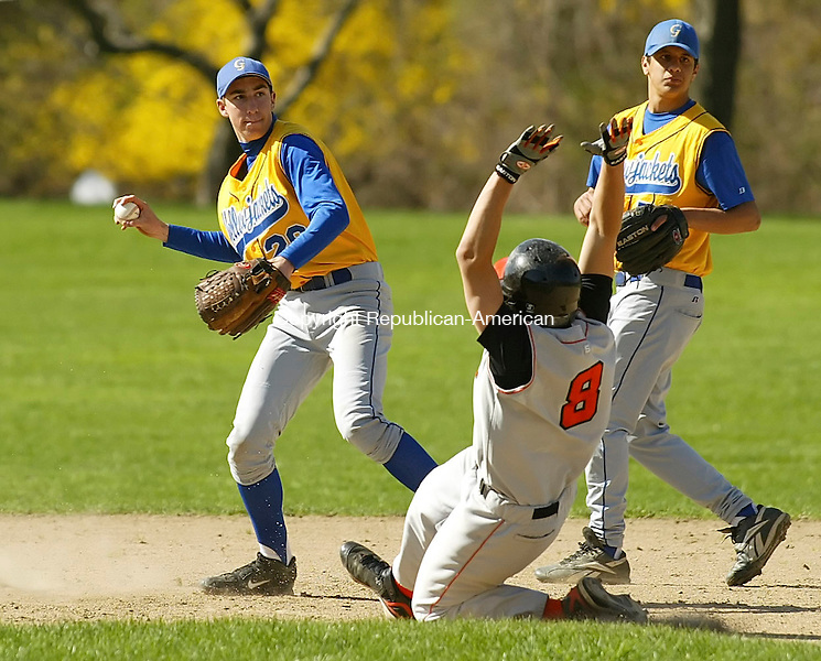 WINSTED, CT 4/30/07- 043007BZ03- Gilbert's Zach Tuozzo (29) looks to first after making the tag at second on Terryville's Kevin LaRose (8) <br /> during their game at Walker Field in Winsted Monday.<br /> Jamison C. Bazinet Republican-American