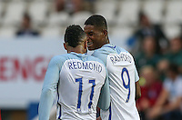 Marcus Rashford (Manchester United) of England jokes with Nathan Redmond (Southampton) of England after scoring his hat trick during the International EURO U21 QUALIFYING - GROUP 9 match between England U21 and Norway U21 at the Weston Homes Community Stadium, Colchester, England on 6 September 2016. Photo by Andy Rowland / PRiME Media Images.