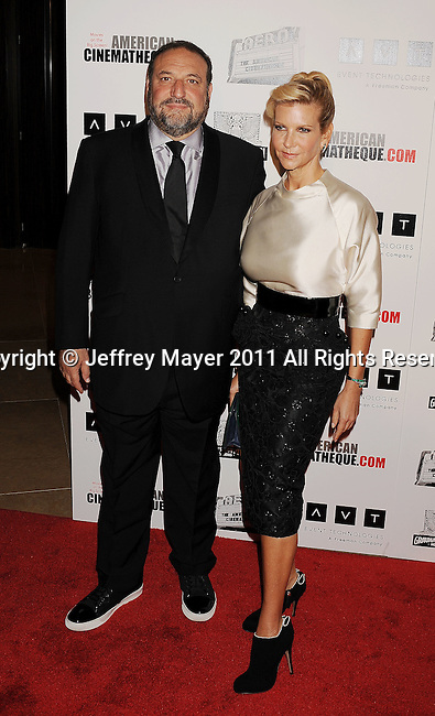 BEVERLY HILLS, CA - OCTOBER 14: Joel Silver and Karyn Fields arrive at the The 25th American Cinematheque Award Honoring Robert Downey Jr. at The Beverly Hilton hotel on October 14, 2011 in Beverly Hills, California.