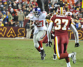 Landover, MD - December 21, 2009 -- New York Giants running back Brandon Jacobs (27) carries the ball against the Washington Redskins in first quarter action at FedEx Field in Landover, Maryland on Monday, December 21, 2009..Credit: Ron Sachs / CNP.(RESTRICTION: NO New York or New Jersey Newspapers or newspapers within a 75 mile radius of New York City)