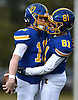 Matthew Sluka #10, Kellenberg quarterback, left, gets congratulated by Robert Filshie #81 after running 36 yards for a touchdown on the Firebirds' first play from scrimmage in the NYCHSFL Class AA final against Xavier (Manhattan) at Mitchel Athletic Complex in Uniondale on Saturday, Nov. 17, 2018. Sluka totaled five touchdowns (three rushing, two passing) with 111 yards on the ground and 111 yards in the air to lead his team to a 41-6 win.
