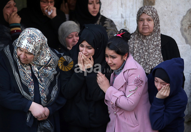 Relatives of 23-year-old Bilal Zayd, who was shot dead as he was attempting to ram his car into an Israeli military post northeast of Jerusalem, mourn during his funeral on December 24, 2015, in the Qalandiya refugee camp near the West Bank city of Ramallah. Photo by Shadi Hatem