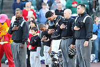 Rochester Red Wings Catcher Wilson Ramos with umpires Alan Porter, Chris Bakke, and Matt Arcovic during a game vs. the Louisville Bats Friday, May 14, 2010 at Frontier Field in Rochester, New York.   Rochester defeated Louisville by the score of 13-4.  Photo By Mike Janes/Four Seam Images