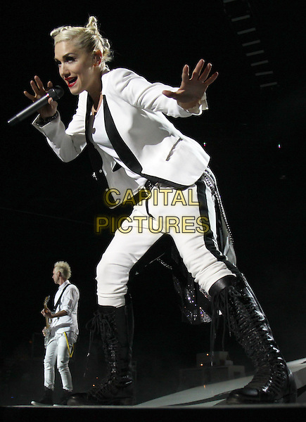 GWEN STEFANI of No Doubt.Made a stop on their 2009 tour at the Lakewood Amphitheater, Atlanta, GA, USA..June 5th, 2009.stage concert live gig performance music white black jacket top boots full length singing bending .CAP/ADM/DH.©Dan Harr/AdMedia/Capital Pictures.