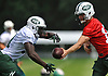 Josh McCown #15, right, hands off to Jordan Todman #31 during New York Jets Training Camp at the Atlantic Health Jets Training Center in Florham Park, NJ on Thursday, Aug. 10, 2017.