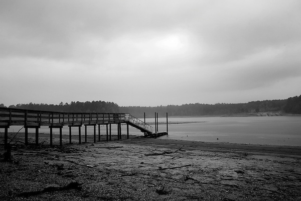 October 18, 2007, Wake County, NC.. A now unneeded pier sits on dry land.. Images from Falls Lake, the main water source for Wake County, NC, which includes the capitol city of Raleigh.. As the seriousness of the drought in the southeastern US continues to grow, Wake County has instigated mandatory water restrictions to help sustain their shrinking water supply.