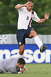 27 June 2008: The United States' Austin Oldham (9) jumps over Bridge goalkeeper Brendan Shumberger (00). The United States 2009 Under-17 Men's National Team lost to the Bridge FC U16s 1-3 at McPherson Stadium at Bryan Soccer Park in Brown's Summit, NC as part of the U.S. Soccer Federation Development Academy Summer Showcase which is part of the 2007-2008 regular season.