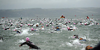 Pictured: Ironman athletes take to the sea in Tenby Pembrokeshire, Wales, UK. Sunday 10 September 2017<br /> Re: The Ironman Wales triathlon has returned to Pembrokeshire for a sixth time.<br /> More than 2,000 endurance athletes are taking on one of the most challenging courses in the sport, starting and finishing in Tenby.<br /> It includes a 2.4 mile (or 3.8km) swim, a 112 mile (or 180km) bike ride and 26.2 mile (or 42km) run within 17 hours.