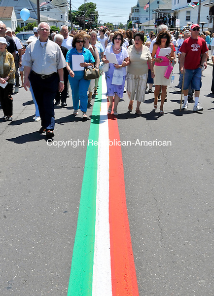 WATERBURY, CT-12 JULY 2009-071209JS02- Following the newly painted Italian tri-colors on Highland Ave. in Waterbury, parishioners from Our Lady of Mount Carmel Church participate in the annual procession with the Virgin Mary statue on Sunday. The parade is part of the church's annual feast. <br /> Jim Shannon Republican-American