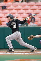 Dustin Hood #21 of the Wake Forest Demon Deacons follows through on his swing versus the Clemson Tigers at Doug Kingsmore stadium March 13, 2009 in Clemson, SC. (Photo by Brian Westerholt / Four Seam Images)