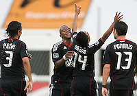Andy Najar #14 of D.C. United congratulated after scoring thee first goal by Juan Manuel Pena #3, Rodney Wallace #22 and Chris Pontius #13 during an MLS match against Chivas USA at RFK Stadium, on May 29 2010 in Washington DC. United won 3-2.