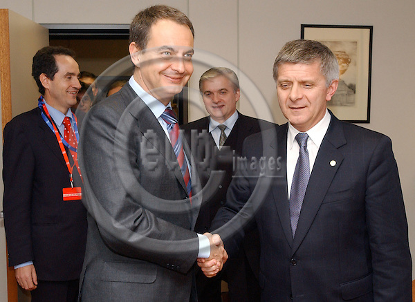 Brussels-Belgium - December 17, 2004---European Heads of State and Government and Foreign Ministers meet for the summit / European Council, at the 'Justus Lipsius', seat of the Council of the European Union in Brussels; here, José Luis Rodríguez ZAPATERO (le), Prime Minister of Spain, with Marek BELKA (ri), Prime Minister of Poland, during a bilateral meeting in the Polish Delegation office at the Justus Lipsius; in the background: Carles CASAJUANA PALET (le), Spanish Ambassador Representative to the EU Political and Security Committee (PSC), and Vlodzimierz CIMOSZEWICZ (ri), Minister for Foreign Affairs of Poland---Photo: Horst Wagner/eup-images