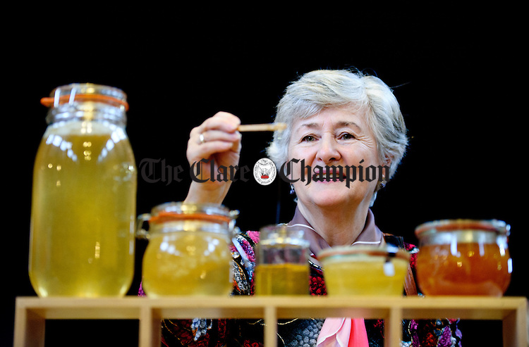 Quin's Marian Hayes tastes some Burren Wildflower honey during the Burren Food Fayre in the Pavilion, Lisdoonvarna as part of the Burren Winterage Weekend. Photograph by John Kelly.