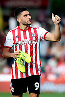 Neal Maupay, scorer of two goals for Brentford, celebrates at the final whistle as he acknowledges the home fans during Brentford vs Wigan Athletic, Sky Bet EFL Championship Football at Griffin Park on 15th September 2018