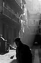 """Courtyard of an old working class apartment block at Ticinese district in Milan, January 1986. This kind of houses were named as """"case di ringhiere"""" (houses with balustrade) and were built in Milan to host workers of the rising chemical and mechanical industries at the last 20 years of XIX century. © Carlo Cerchioli ..Cortile di casa di ringiera di Ripa di Porta Ticinese al quartiere Ticinese a Milano gennaio 1986. Questo tipo di case popolari vennero costruite per gli operai della nascente industria meccanica e chimica negli ultimi venti anni del XIX secolo."""